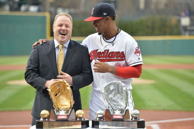 LOVE THE GLOVE:    Steve Cohen of Rawlings, left, presents Cleveland Indians shortstop Francisco Lindor with his Gold and Platinum Gloves before the game against the Detroit Tigers at Progressive Field in Cleveland on April 14.