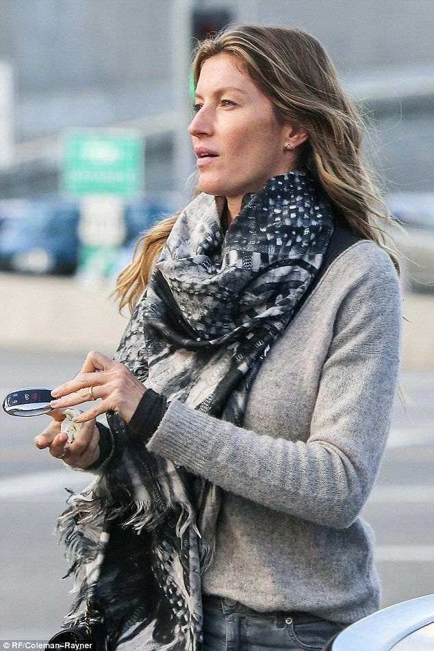 Street style:The 36-year-old's wavy brown hair cascaded freely over the intricately patterned black, grey and white scarf she'd draped round her neck