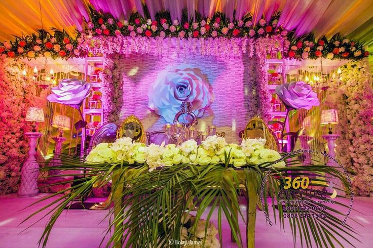 traditional wedding bacdrop with a paper roses details
