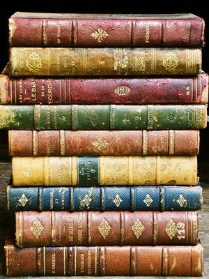 Beautiful old collection of leather-bound colorful Vintage/ Antique books.