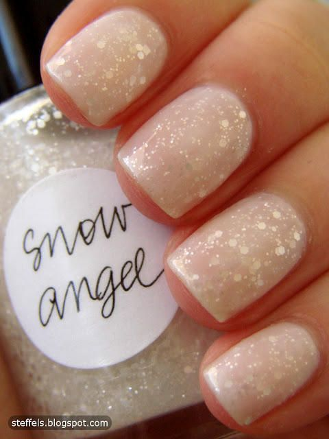 sparkly nude nails.