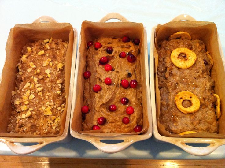 Various sourdough breads - banana walnut, cranberry, and apple (left to right)