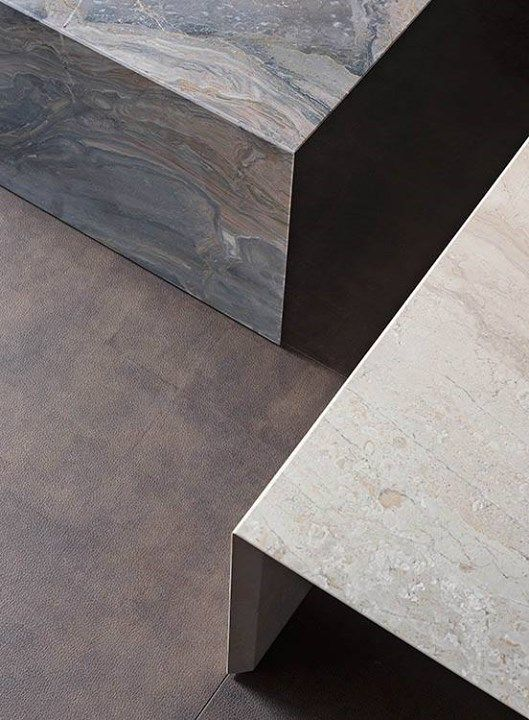 Low-level tables in gray Arabescato Orobico marble and beige Corallo marble: a…