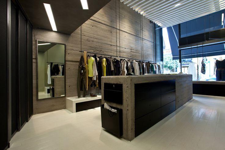 Industrial, Bare concrete, Badila Retail Store interior. To see the whole project visit http://www.akpraxis.gr/portfolio/badila-kifissia/