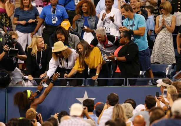 Serena Williams celebrates with her mother Oracene Price & Jill Smoller with sisters Lynn & Venus standing in the back row & Eisha in the front row after defeating Victoria Azarenka in the 2012 US Open Women's Singles Championship Final.