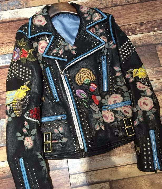 An absolutely stunning leather biker jacket. This leather motorcycle jacket is adorned with metal studs and intricate embroidery and painted detailing. A statement jacket that looks great paired with