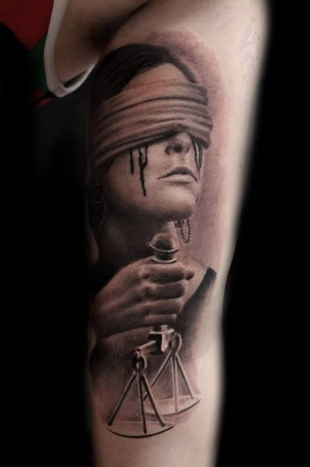 lady of justice naked tattoo