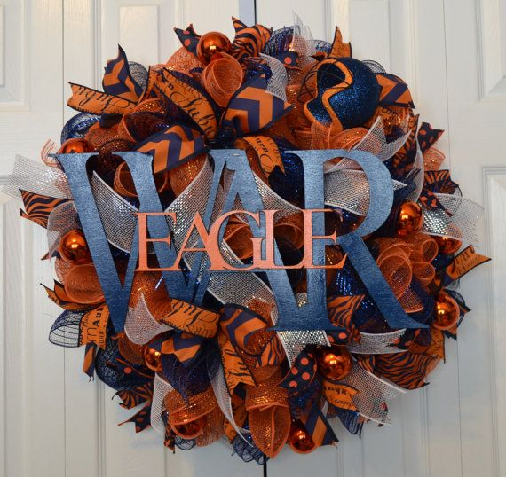 This festive wreath is made up orange and navy blue Deco Mesh and filled with four different fun ribbons! Also included are orange ornaments, a football helmet, and of course a good 'ol WAR EAGLE!