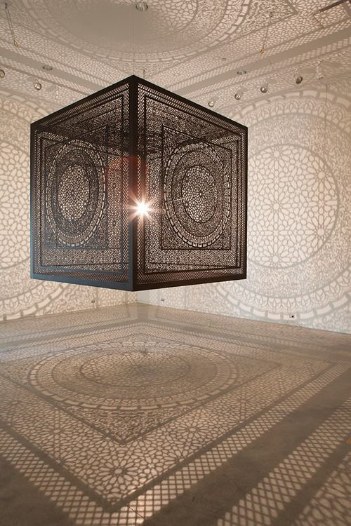 Artist Anila Quayyum Agha projects stunning shadows onto the surrounding room using a single light source within this intricately cut wooden...
