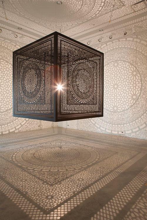 Intersections, a instalação consiste em um único ponto de luz cercado por um cubo de madeira de 1,98m, completamente recortado à laser e suspenso, As sombras dos desenhos se projetam no ambiente e produzem textura nas paredes, chão e teto por 10,66m.