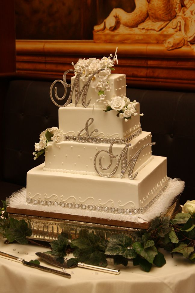 Wedding cake with double crystal monogram displaying bride and groom's initials. #monogram #wedding-pinned by wedding specialists http://dazzlemeelegant.com