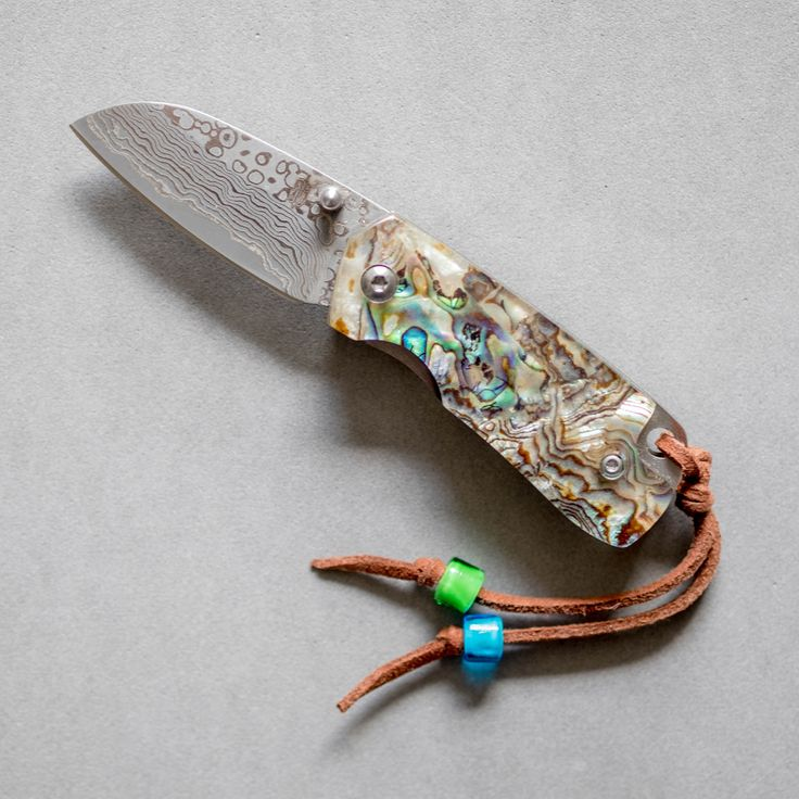 Small, Classy and Refined Gentleman's Folding Knife The BucknBear Small Abalone Folder is the perfect pocket knife for the refined gentleman. If you're attendin