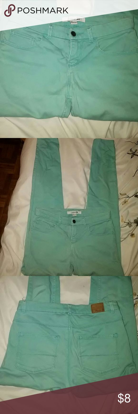 Forever 21 Aqua Teal Skinny Stretch Pastel Jeans A pair of mint green skinny jeans featuring a mid-rise fit, classic five pocket design and a zip fly. Pairs perfectly with summer sandals and an oversized camel brown handbag or dress them up with a statement necklace and pumps! Forever 21 Jeans Skinny