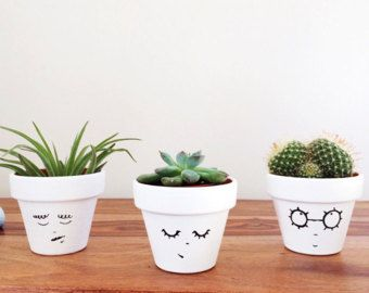 Im so happy to introduce you to Lily Senior, the plant pot. If youre a lover of all things cute and minimal, shed love to add some style and a smile to your everyday!  This plant pot is perfect for cacti and succulents; try different plants to give Lily Senior a different hairstyle and personality. Each plant pot is carefully hand-painted and sealed for water protection, making it a special and unique gift for a loved one, or the perfect little treat to brighten your home or office. ■ Size…