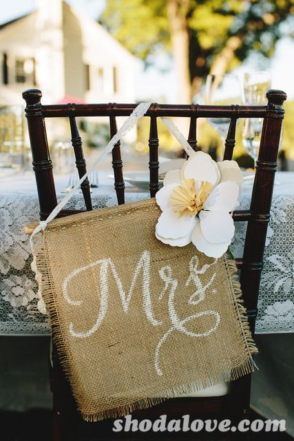 for the head table with a Mrs. & Mr. Sign. I like how it is mixed with lace tablecloth. We would change the flower of course.