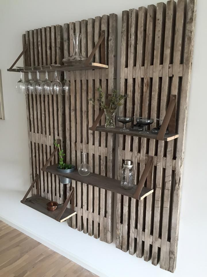 DIY wall mounting with shelves all made from recycled wood and pallet frames. Genius!