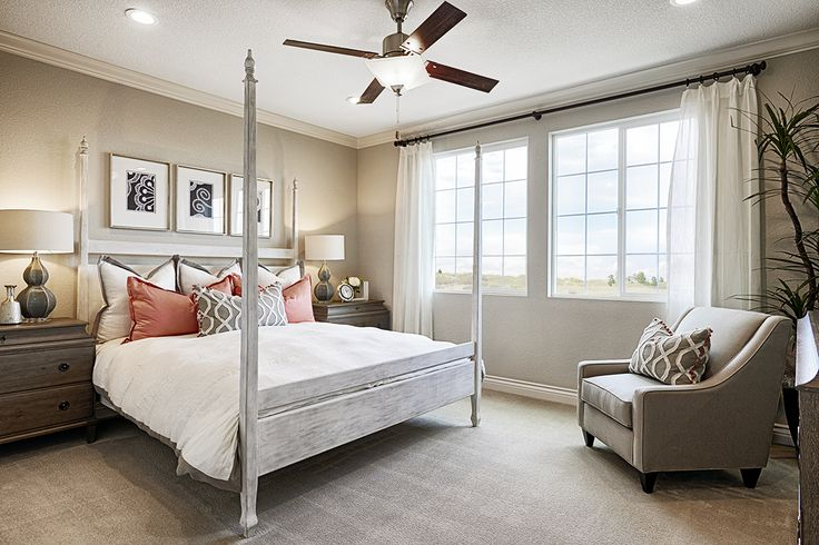 A classic four-poster bed creates immediate sophistication | Bernard model home | Oakley, CA | Richmond American Homes