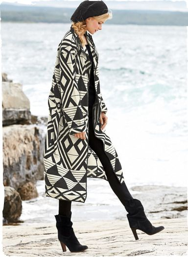 Black and white and gorgeously graphic, the artsy, double-faced knit coat in baby alpaca (70%) and wool (30%) is patterned with African geometrics. Long, easy and simply modern with patch pockets, turn-back cuffs and minimally styled buttonless placket.