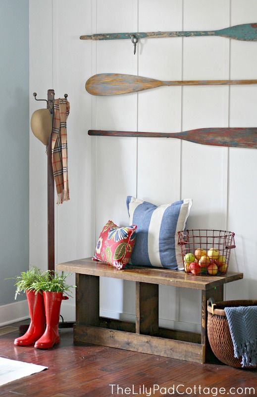 Nautical entryway with wood bench and wall oars. Top ten entryways: http://www.completely-coastal.com/2013/09/top-10-entryway-decor-ideas-with.html