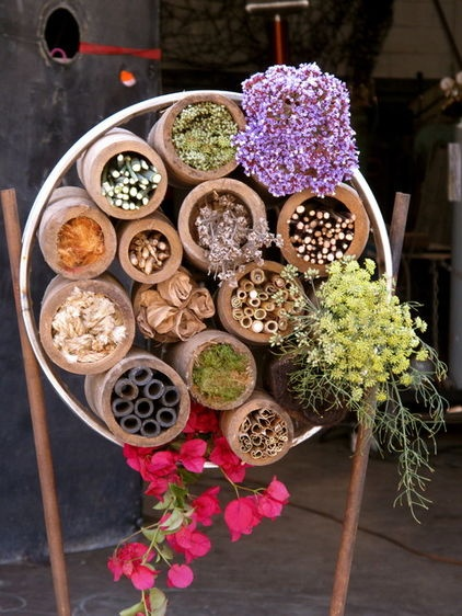 create a habitat for a multitude of pollinators by providing a seasonal assortment of flowers and tubes — decorative as well as functional.