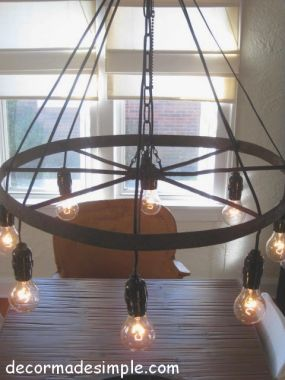 Rustic Chandelier Using Exposed Lightbulbs Rather Than Candles Wagon Wheel