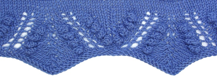 Mimosa Border has the added interest of bobbles.  It can be found in the Edging Stitches category.