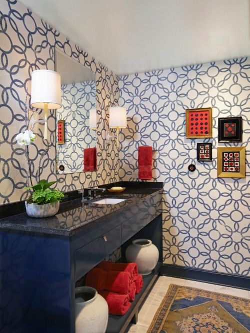 eclectic bathroom with navy blue and pattern wall