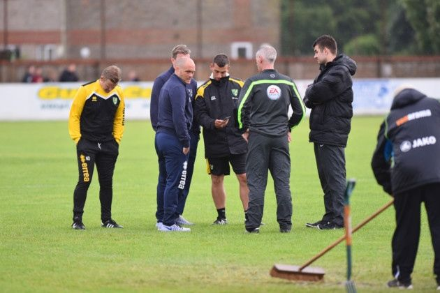Norwich City boss Alex Neil on the pitch at Lowestoft Town talking to the officials prior to Tuesday night