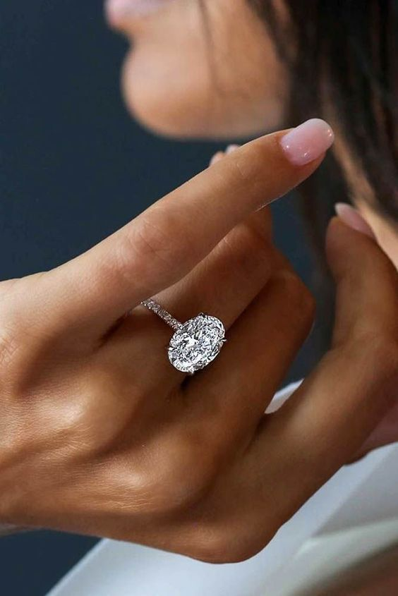 Beautiful 2ct oval engagement ring with micro pave band!