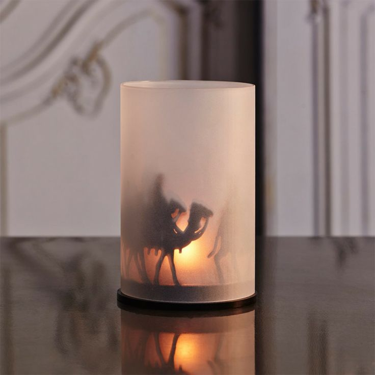 A warm nativity scene shines through when a single tealight is placed inside.
