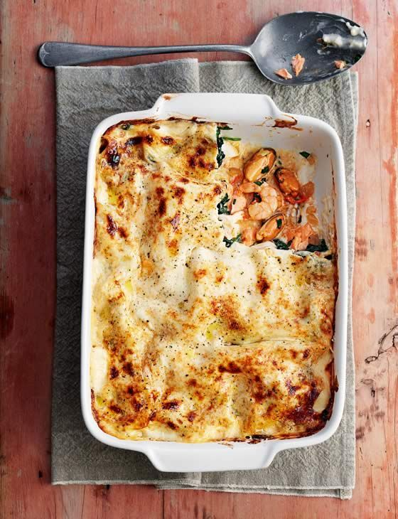 Luxury seafood lasagne. Delicious Italian pasta dish recipe with mussels, king prawns and salmon.