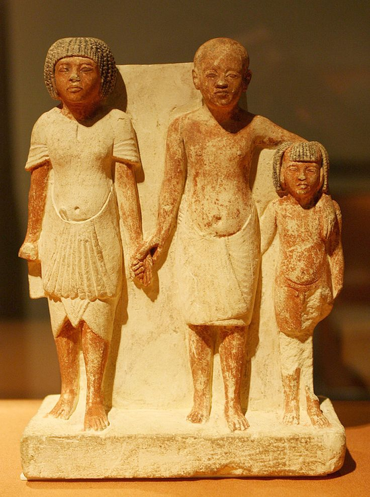 https://flic.kr/p/8UtiKP | An Egyptian New Kingdom Amarna Period Painted Limestone Sculptural Group: Two Men and a Boy | Painted limestone, New Kingdom, Amarna Period, Dynasty XVIII (Reign of Akhenaten), ca. 1349-1332 B.C.E., From Gabelein, Upper Egypt  This intriguing group has been variously interpreted as a family comprising a grandfather, a father, and a son and as one man at three different stages of life; the seeming affection expressed by the three figures supports the first…