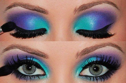 Aqua and purple 80s-style eye makeup with lots of black mascara. Totally rad!