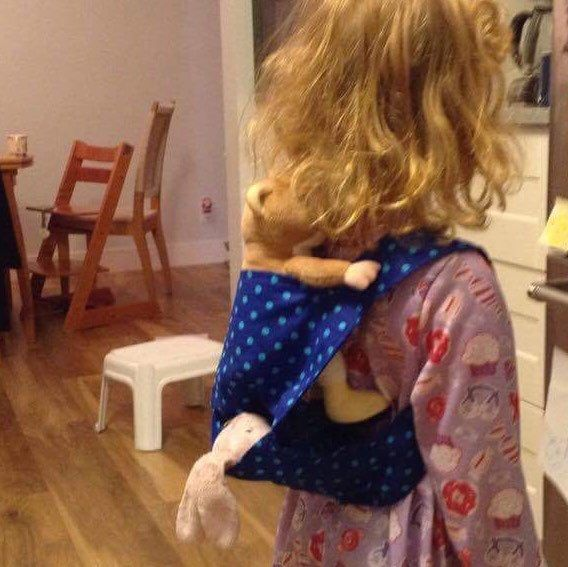 When worn inside out, the pocket on the Easy Doll Carrier makes it possible to carry 2!    (Customer provided photo, posted with permission)