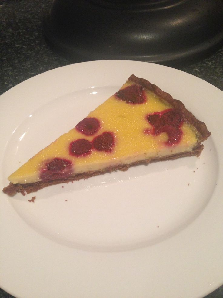 Coconut custard and raspberry tart with chocolate pastry