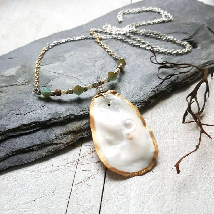 SALE!! 15% off all orders over €30! Like this Mixed Metal Irish Oyster Shell Pendant 💛