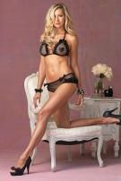 You'll fall in love with sultry lingerie set when you will be dripping with sexiness in this divine two piece fishnet bra top and matching rumba brief set. This super sexy set is trimmed with lace ruffles and adorned with demure black satin bows. The bikini style bra top is accented with sequinned heart-shaped pasties and the net panties are made from a matching sequin net.