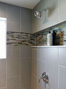 Tiled standing shower. Long shower ledge. Toiletry ledge/shelf.