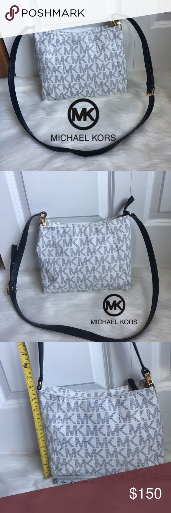 Micheal Kors Crossbody! Good used condition!! Very cute Crossbody purse with adjustable strap. In navy blue and white. Perfect for summer! Beautiful MK gold logo on side. Cool small pocket hidden shown in 5th picture. No stains, tears, or marks. Very cute will definitely get compliments! Check out my closet for other name brand items!! Michael Kors Bags Crossbody Bags
