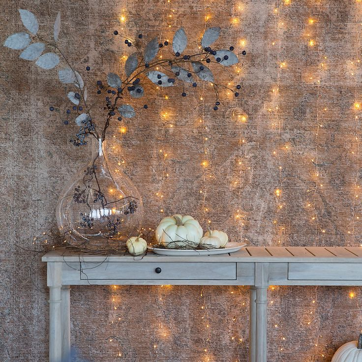 Found only at terrain, this multi-strand curtain includes eight connected strands of LED lights to illuminate the home indoors and out. The strands in