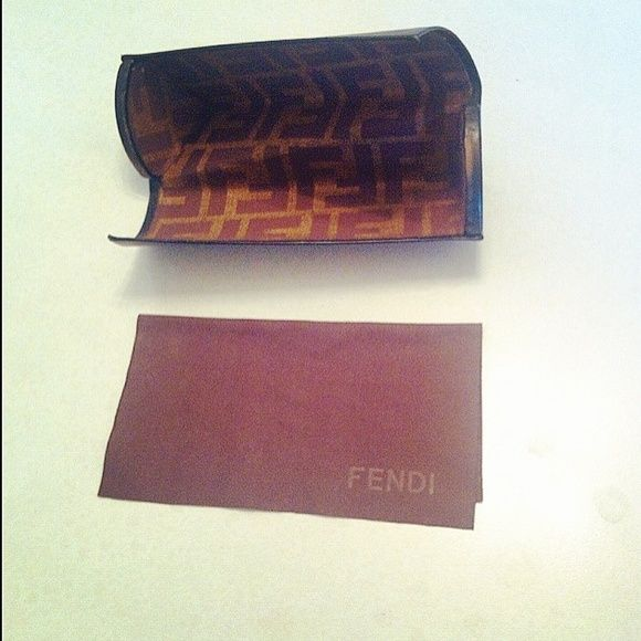 Fendi Eyeglass Case With Fendi Cloth Very nice dark brown Fendi eyeglass case with Fendi pattern inside, includes Fendi Cloth to wipe your eyeglasses with. FENDI Accessories