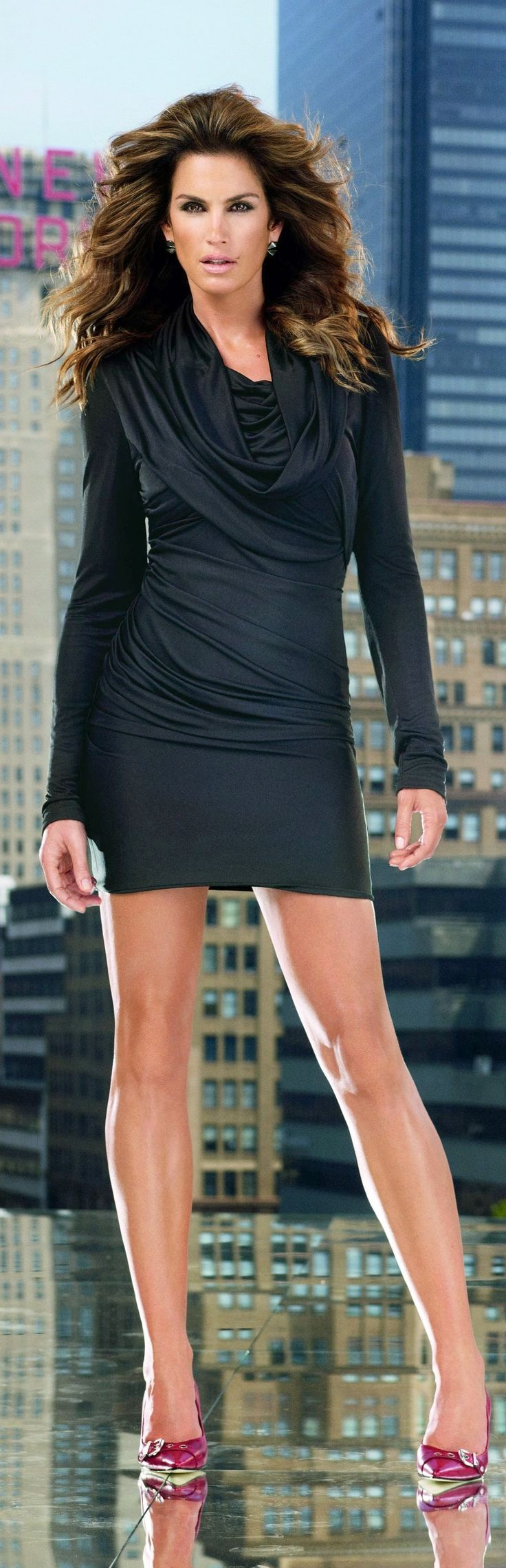 Cindy Crawford by Versace /2010 ~ the dress is cute but she looks like she has a hair blower in her face