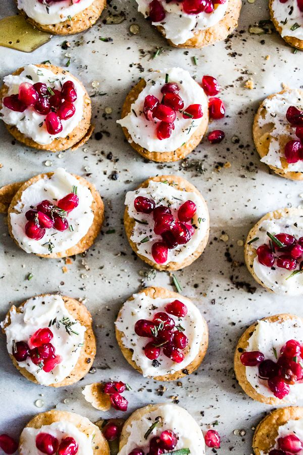 These beautiful whipped goat cheese pomegranate bites are made in less than 30 minutes and are the perfect stunning holiday appetizer. Store bought pie crust is cut out and baked into little flakey cracker rounds and topped with honeyed whipped goat cheese, pomegranate seeds and a sprinkling of honey and rosemary. You will love this new quick and easy holiday appetizer!