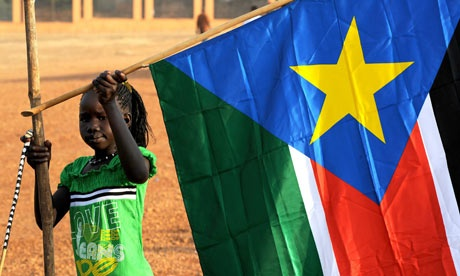 A girl holds a South Sudan flag during the announcement of the preliminary results of voting in Sudan in January, when the south overwhelmingly voted to split from the north. Photograph: Ho/Reuters