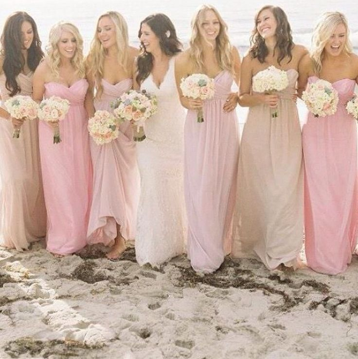 Beach wedding, so laid back. Love the colours of the dresses.