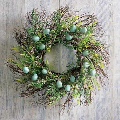 twig wreath with robins' eggs scattered about it — so sweet!
