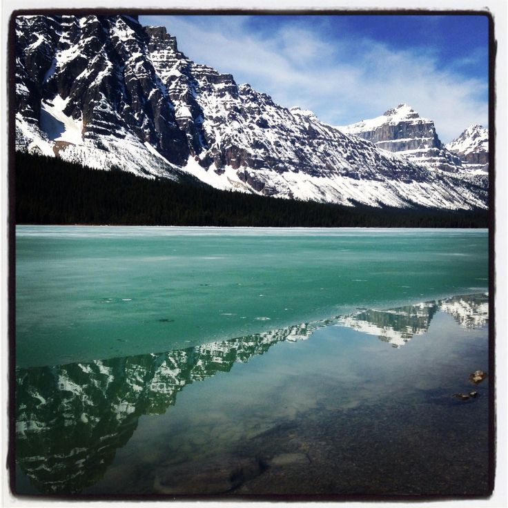 Reflection in an icy lake. Canada.