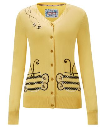 """You're never too busy to make a bold and bright impression. This sunny style with funky bee applique pockets and embroidery will make you and everyone you meet smile. Approx Length: 62cm Our model is: 5'9"""""""