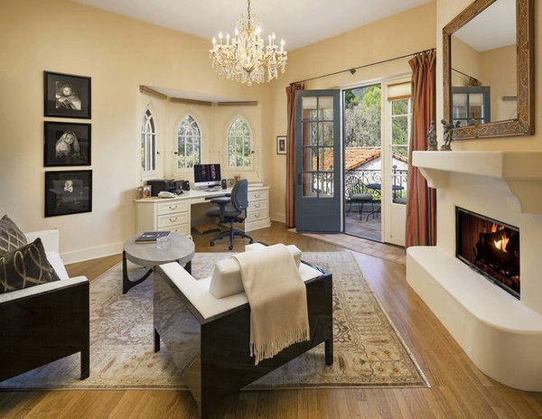 JEFF BRIDGES CALIFORNIA COMPOUND 2015 <> Luxe Workspace  The home office features its own fireplace and French doors leading out to a roof terrace.  Source:Jim Bartsch