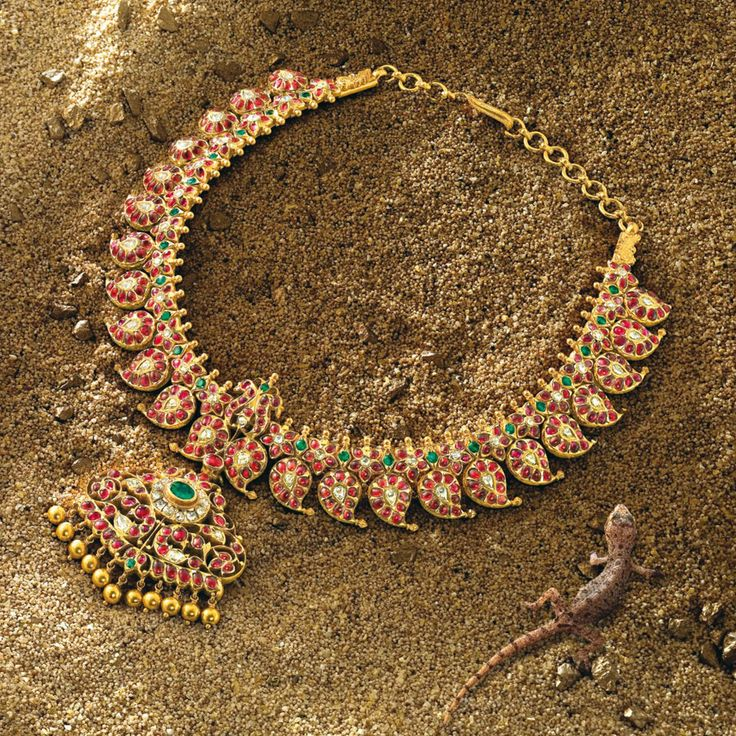 The Heritage Line, Ganjam necklace. Rubies, emeralds, gold beads and diamonds set in 22k yellow gold. Price on request.